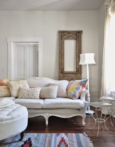 What a charming parlor room! Love the elegant couch mixed with the southwest style rug! Mixing styles may feel wrong, but if you can pull off a look like this then it is worth the chance!
