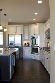 I like this kitchen layout with wall ovens on the corner. White cabinetry and wide plank dark wood floors Kitchen Corner, House, Home, Off White Kitchens, Elegant Kitchens, Kitchen Layouts With Island, Home Kitchens, Kitchen Layout, Kitchen Design