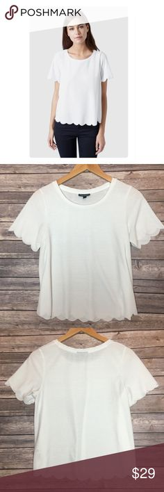 """Topshop Scallop Frill Tee Not your basic white tee!  Adorable crisp white tee by Topshop.  Rounded neckline with scalloped trip of sleeves and bottom hem.  Top is in excellent condition and shoulder be a staple to your wardrobe.  Material tag has been listed.   Measurements laid flat: Bust:  18"""" Length from top of shoulder:  21"""" *Measurements are approximate. Topshop Tops Tees - Short Sleeve"""