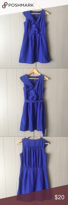 "Gorgeous Royal Blue Dress✨ This is such a beautiful dress. It would be perfect for hat special occasion. Ruffled cascading collar on on side and it has pockets. Skirt is lined. Zips on the side. 100% Polyester. It is in excellent used condition. Armpit to armpit is 18"". Length is 34"". Very J Dresses Mini"