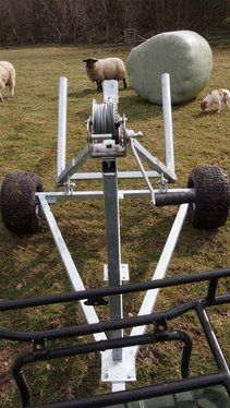 ATVbale trailer and the winch.The single bale trailer can move large round bales of hay, silage or straw with ease using an ATV, compact tractor, or four wheel drive vehicle. For info: http://www.fresh-group.com/atv-bale-trailer.html