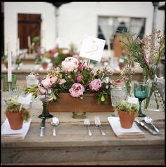 I like that the table number was put into the flowers.