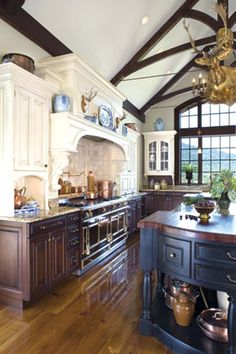 Portfolio Kitchens marries elegance with country-style warmth in a Madison County, Virginia, farmhouse : The Ornate La Cornue Stove Is Toppe...