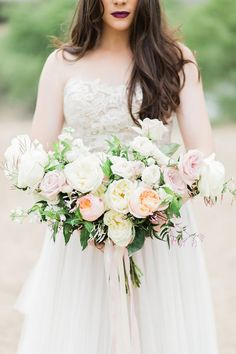 Breathtaking Wedding Bouquet: Romantic bridal bouquet of blush, cream and peach garden roses. Click to blog for more gorgeous bouquet ideas.