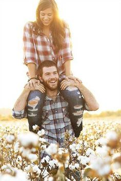 Cute engagement photo... James A Reed wildlife park in LS MO has a field of sunflowers for this!