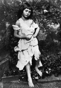 "Photos of Alice Lidell – The girl who was the inspiration for ""Alice in the Wonderland"".  Liddell dressed up as a beggar-maid. Photo by Lewis Carroll (1858).Source"