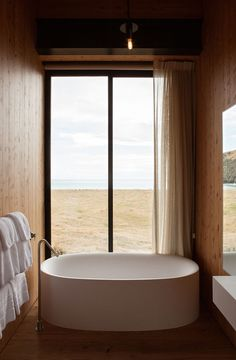 Holiday escape called Scrubby Bay House in Annandale, New Zealand, by Pattersons Architects | Photo by Simon Devitt | via Style and Create