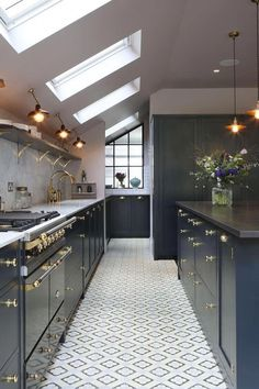 This side extension makes such a difference for the galley style kitchen. I like the sloping roof and patterned flooring. Brass coloured handles and navy kitchen units are a perfect pair Kitchen Styling, Kitchen Ceiling, Kitchen Renovation, Galley Style Kitchen, Contemporary Kitchen, Kitchen Remodel, Kitchen Design, Kitchen Ceiling Lights, Best Kitchen Lighting