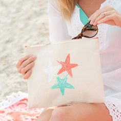 New! Our Preppy Starfish Monogrammed Canvas Accessories and Cosmetics Pouch is the ideal zip pouch to help organize any accessories and necessities. A perfect sized accessory bag for the beach, pool or every day and holds everything from makeup to sunglasses and a swimsuit or an iPad! The handy wrist strap makes this a versatile little take-a-long.  www.beaujax.com