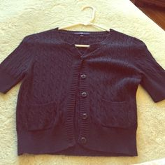 Short sleeve, crop, cable knit cardigan So preppy, so perfect! Navy blue cardi - perfect for all those summer Lilly dresses! Crop length with little front pockets. GAP Sweaters Cardigans