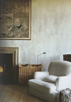 Matte wall, interesting art, fireplace with wicker basket for wood