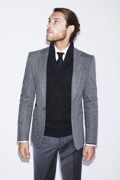 Shop this look on Lookastic:  http://lookastic.com/men/looks/dress-pants-blazer-shawl-neck-sweater-tie-dress-shirt/7022  — Charcoal Dress Pants  — Grey Wool Blazer  — Black Shawl Neck Sweater  — Black Silk Tie  — White Dress Shirt