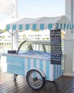 Ice cream cart.  Rounded display case.