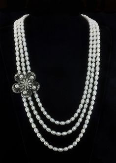 "Vintage Pearl Necklace  Three strands of 8mm genuine fresh water pearls, with a vintage look rhinestone, crystal and pearl embellishment. Lobster claw clasp. Length is 34"""".   http://www.sterlingjewelrystores.com/product619.html"
