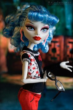Ghoulia's favorite color is cherry red.  Her favorite food is: Brains!  (Just kidding). She  actually has quite the affinity for rapidly prepared, mass-market cuisine. (Translation: Ghoulia likes fast food.)