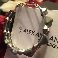 Retired Alex and Ani Glacier Impulse Beaded Bangle This is a super fun Alex and Ani double wire expandable bangle that looks fabulous on, dressed up or down.  Part of the Indie Spirit Collection in colors of silver, grey and Khaki tones and is in New without tag condition.  I am selling duplicates within my personal collection. NO Trades.  Will come with A&A box and care card. Alex & Ani Jewelry Bracelets