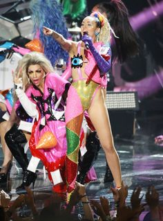"""Pin for Later: See Every Supercrazy, Revealing Outfit Miley Cyrus Wore at the VMAs! Look 10 Miley took to the VMAs stage for a surprise performance, where she performed her new song, """"Do It,"""" in a sequined, asymmetrical colorblock bodysuit."""
