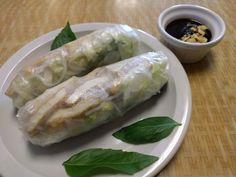 Fresh springs rolls with vermicelli noodles, lettuce, cucumbers, basil, and tofu.