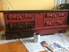 Painting Primer Red on old cedar chest. 10/2015