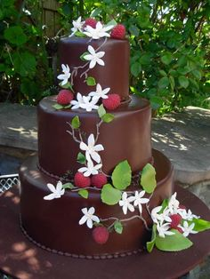 Chocolate Ganache Wedding Cake decorated with Raspberries and Fondant Flowers and Leaves