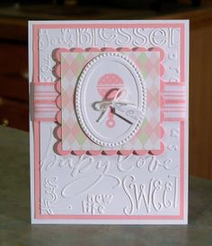"Congratulations Baby Girl Card - This card was also made using the Stampin' Up stamp sets ""Button Buddies"" & ""Fancy Flexible Phrases, card stocks, embossing folders, ink, spellbinders square scallop die & wide grosgrain striped ribbon. The designer paper is by K&Company. The finishing touches for this card is the tiny tag, which says ""Too Cute"" and the small bakers twine bow."