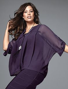 Feminine pintuck pleats align the boxy silhouette of our chiffon blouse for a dramatic look that's seriously flattering. Loose & flirty dressed up or down, this sheer number tops your favorite layering piece with a sleek collarless design and draping tab & button 3/4 sleeves. #LaneBryant