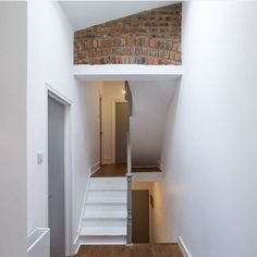 5 DIY Reclaimed Brick Tile Projects to Transform Your Home - www.vintagebricks.com   reclaimed brick tile inlay art in awkward hallway space