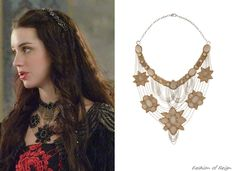 In the sixteenth episode Mary wears this Deepa Gurnani Flower Bib Necklace in black. You can find this necklace in pink here for $97.50.