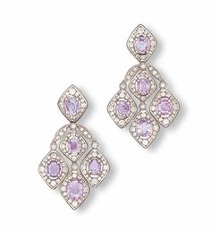 A PAIR OF PINK, PURPLE SAPPHIRE AND DIAMOND EAR PENDANTS, BY REPOSSI    Each set with an oval-shaped light pink sapphire within a diamond surround suspending three similarly-designed tassels with light pink and purple sapphires, mounted in 18k white gold, 6.3 cm long, with French assay marks for gold, in Repossi black suede case    Signed Repossi