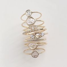 Our Tidals Ring surrounded by a few Sapphire Slice Rings, Small Diamond Slice Rings and rose cut Trinity Ring. Pavé Perseids and Moss Rings for a little extra holiday sparkle! #valejewelry #alternativebride #engagementring #diamondring #weddingband...