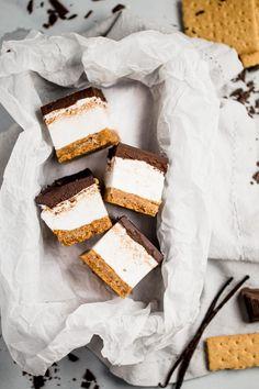 s'mores bars sandwich a thick layer of fluffy homemade vanilla bean marshmallow in between graham cracker crust & salted dark chocolate ganache