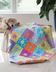 This is a bright, lively and simple quilt for baby. It's so quick to piece, you can make it the day before a baby shower.