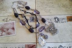 Purple, Black and Pewter Metal Flower Beads Necklace with Rhinestone & Silver Angel and Acrylic Faceted Oval Bead Pendants on Two Chains