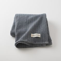 Layer up with lightweight wool. This marled navy weave is made of a cotton-wool blend and backed by a solid cream woolen weave. A slight nod to the denim aesthetic, this throw is a great accent for living rooms and dens, and is particularly useful in bedrooms during chilly winter nights.