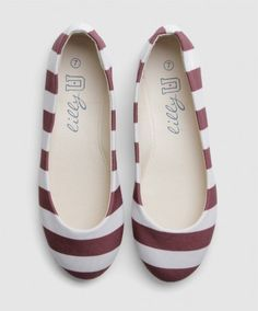 These adorable ballet flats are perfect for everyday wear or on game days. They are made of polyester fabric with synthetic lining and a rubber sole. The feature maroon and white horizontal stripes and a round toe. Size up if you are a half size.