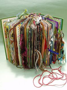 I love the idea of using an old book for scrapbooking, journaling or even just putting pictures in