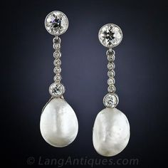 Edwardian Natural Pearl and Diamond EarringsSoft, elegant, feminine beauty radiates from these fabulous ear drops from the turn-of-the-20th century. Masterfully created in platinum to accentuate two matched pairs of natural pearls: velvety, silvery white semi-baroque teardrops swinging below a line of antique-cut diamonds.