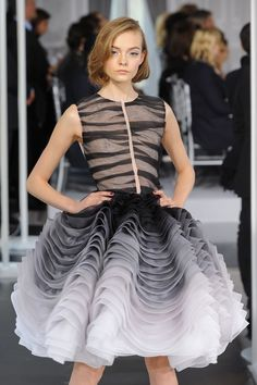 Designer work inspired by Post WWII fashion- Short, full skirt with small waist and high neckline; Dior