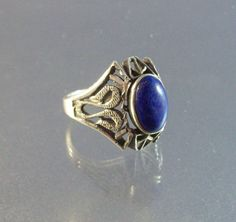 Vintage Sterling Filigree Lapis Ring, Art Deco Size 7.25 by LynnHislopJewels on Etsy https://www.etsy.com/listing/246375302/vintage-sterling-filigree-lapis-ring-art