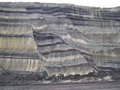 The total throw across a fault zone may not occur entirely on a single fault strand but distributed onto several strands or accommodated by distributed deformation (drag folding) within or adjacent to the fault zone. This fault zone outcrop is in an openpit lignite mine in the late Miocene–Pliocene Ptolemais Basin, West Macedonia, Greece.
