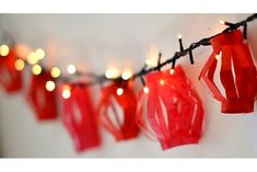 Before you put away the Christmas lights, you may want to leave some out for this simply Chinese New Year decoration idea! Chinese Theme Parties, Asian Party Themes, Chinese New Year Party, Chinese New Year Decorations, Chinese Holidays, New Years Decorations, Diwali Decorations, New Years Party, New Year's Crafts