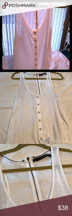 White Linen Snap Front Tank Top Very Sheek white linen with funky detailing makes a great layering piece. I purchased this while on holiday at Martha's Vinyard, it looks great with a tan, lots of wrap bracelets and jean cutoffs! Patterson J Kincaid Tops Tank Tops