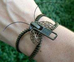 How fun! I love how they used the Vintage Filigree as wings http://www.eebeads.com/_vintage.htm?s=59094    Steampunk Moth Bracelet   Zipper Bracelet by PeteAndVeronicas