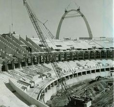 Building the Arch and the original Busch Statium. St. Louis, Missouri.