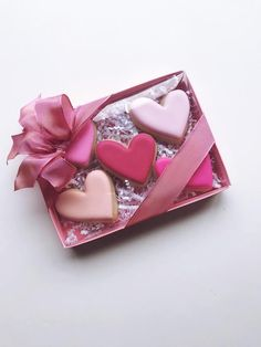 Each little pink box (what do you expect other than pink) includes five sugar cookie hearts with royal icing.* Contact us for custom orders or if you would like your hearts sent to individual a. Valentines Baking, Valentine Desserts, Valentine Cookies, Cookie Favors, Cookie Gifts, Chocolate Shots, Chocolate Covered Treats, Iced Sugar Cookies, Cookie Packaging