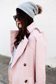 Light pink trench and layered sweater on Kendi Everyday.