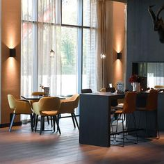 The innovative wood flooring BOEN Oak Smoked Live Pure gives a special look to the restaurant in the Van der Valk Hotel in the Netherlands. The atmosphere is pleasant and sophisticated (images: BOEN). Timber Flooring, Hardwood Floors, Roof Tiles, Joinery, Netherlands, Brick, Van, Restaurant, Colours