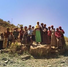 """April 2, 2015: Post from Eduardo Rodriguez, """"A crowd of young onlookers gathers as Mark and Jodi Visser and World Vision meet Girma Wandafrash, a hero of the 1984 Ethiopia famine response. His work with World Vision sparked partnership with the Visser family and was catalyst for restoration in Antsokia Valley."""""""