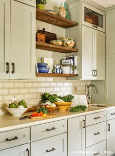 I like the stained wood shelves between the cabinets: Little Rock Arkansas Home Makeover by Kathryn LeMasters