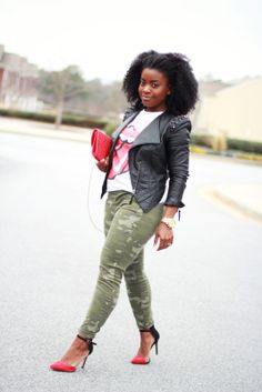 Rocker Chic: Black Leather Moto Jacket; White Tee with Red Graphic; Camo Green Skinny Jeans; Red & Black Pumps; Red Handbag